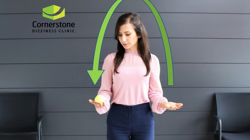 Vestibular rehabilitation exercise at Cornerstone Dizziness clinic in Toronto throwing ball from one hand to the other