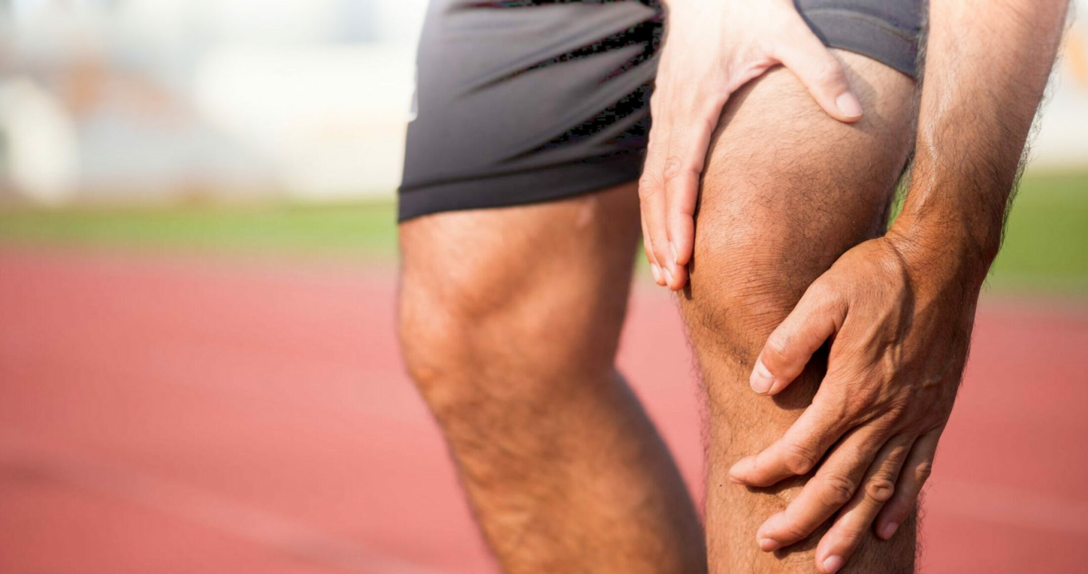 man holding his knee in pain due to runners knee or patellofemoral syndrome
