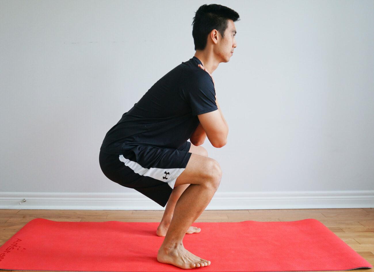 man performing squats